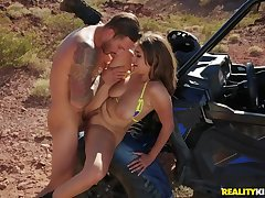 Fucking a big breasted slut out in the desert
