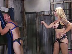 Submissive buddy gets spanked and has to suck strapon worn by Mistress Bella Bathory
