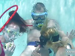 Babes take turns sucking dick underwater and they are as a result adventurous