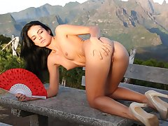 Handsome solo model Sapphira spreads her legs to flash her puss