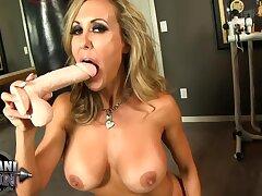 Sexy enforcer playing with dildo in gym - MILF pornstar Brandi love solo