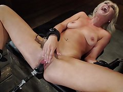 Lilly Siren feeds her shaved cunt with sex toys and her fingers